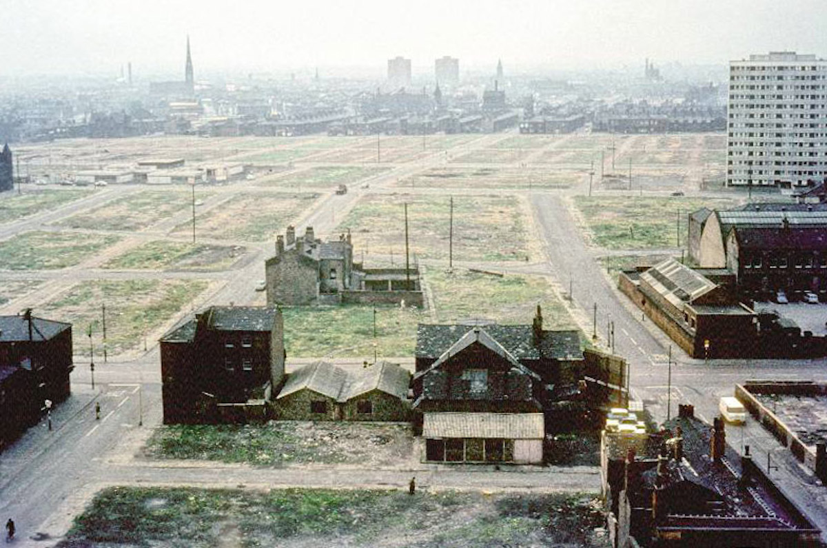 View across Hulme showing areas cleared for redevelopment. Taken from the extension to the Manchester College of Art and Design (the current Chatham Building) around 1966.