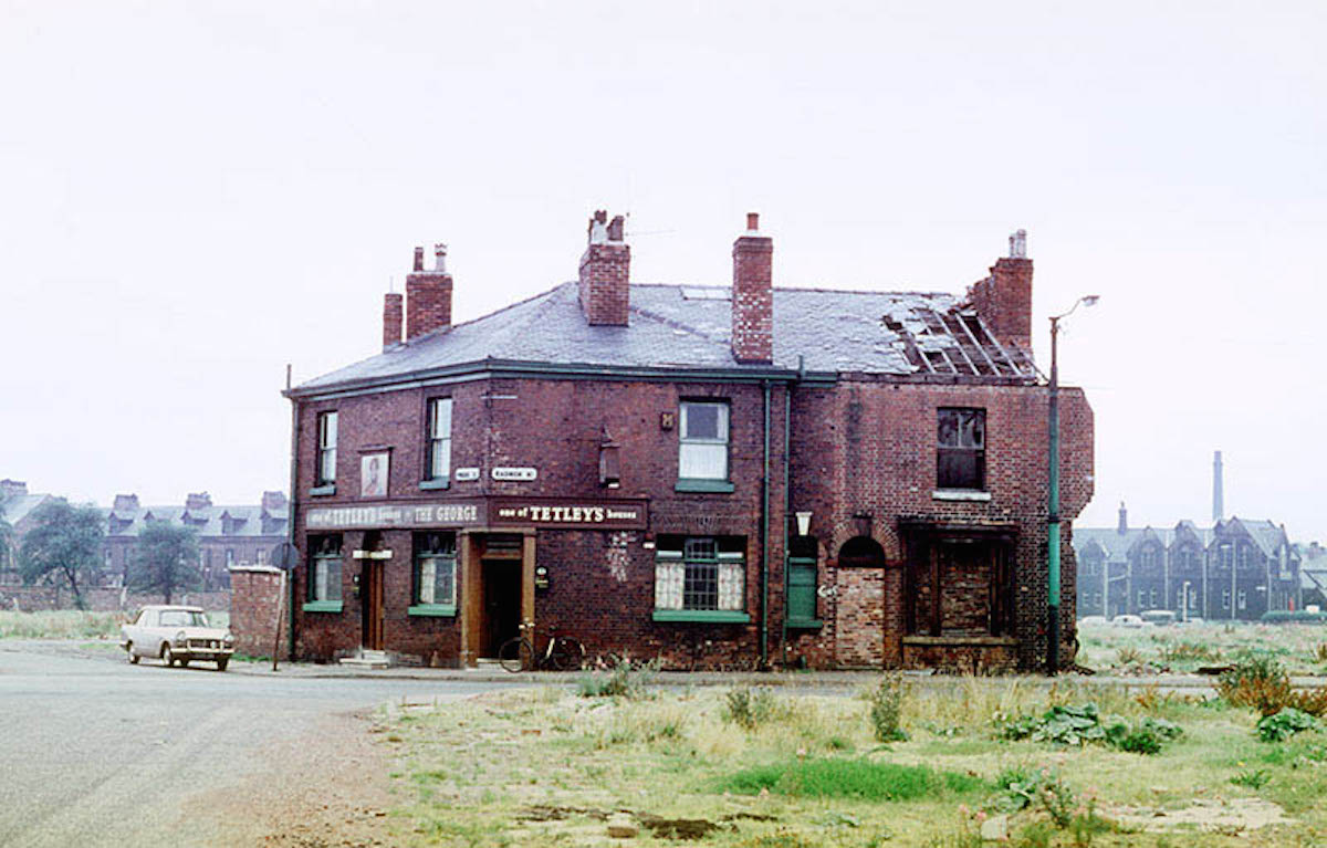 The George Inn on the junction of Radnor Street and Pinder Street, Hulme, left isolated by the demolition of surrounding houses and shops.
