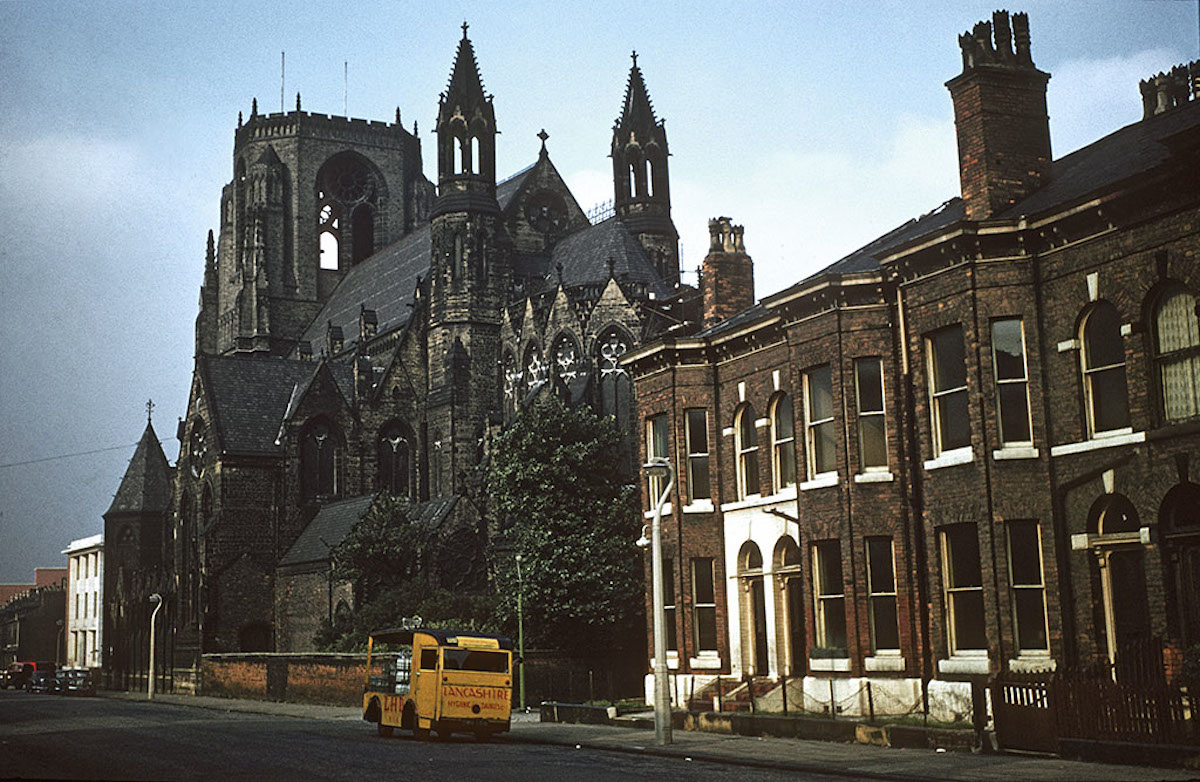 View along Ackers Street towards Oxford Road, showing the Church of the Holy Name from the south east. Photographed in the early 1960s.