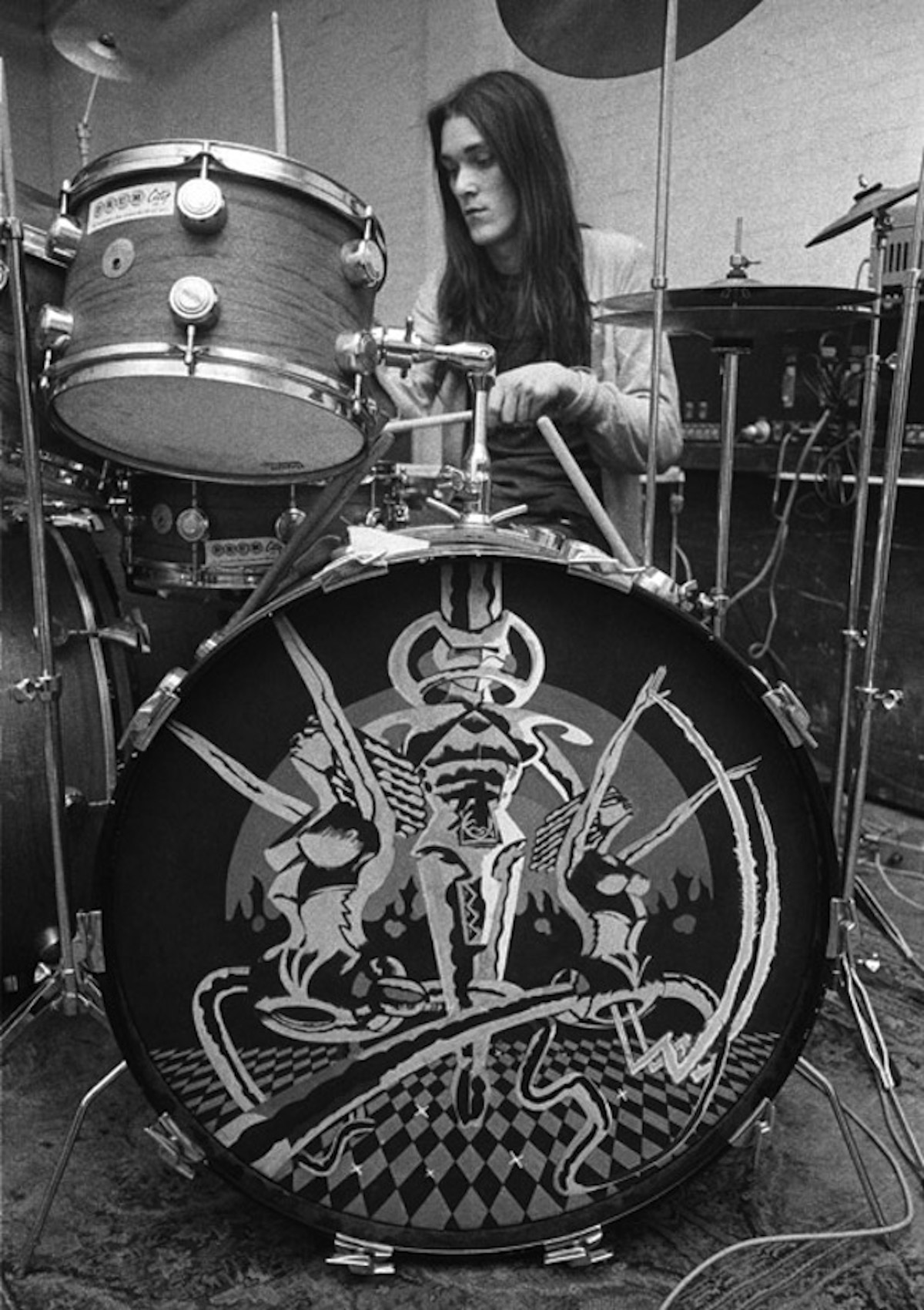 Simon King captured in a 1973 Hawkwind rehearsal with the companion drumhead in the foreground. Photo: (c) Barrie Wentzell/www.barriewentzell.com