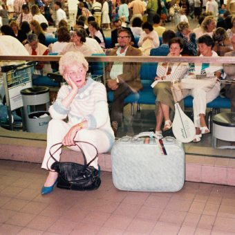 23 Photographs of Passengers At Manchester Airport In June 1987