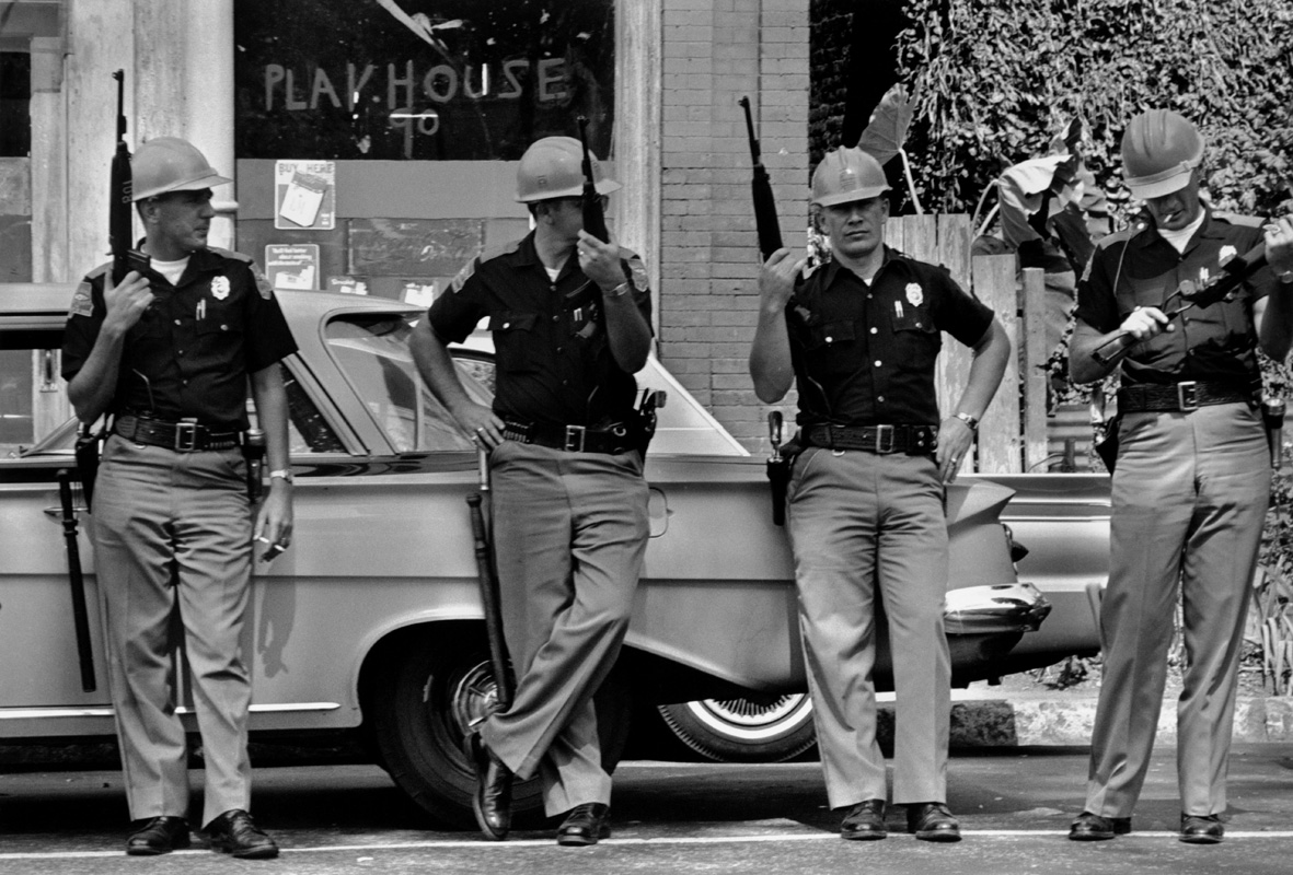 USA. Birmingham, Alabama. 1963.  Members of the Alabama Highway Patrol make a show of force during the morning of the bombing of the 16th Street Baptist Church by the KKK.