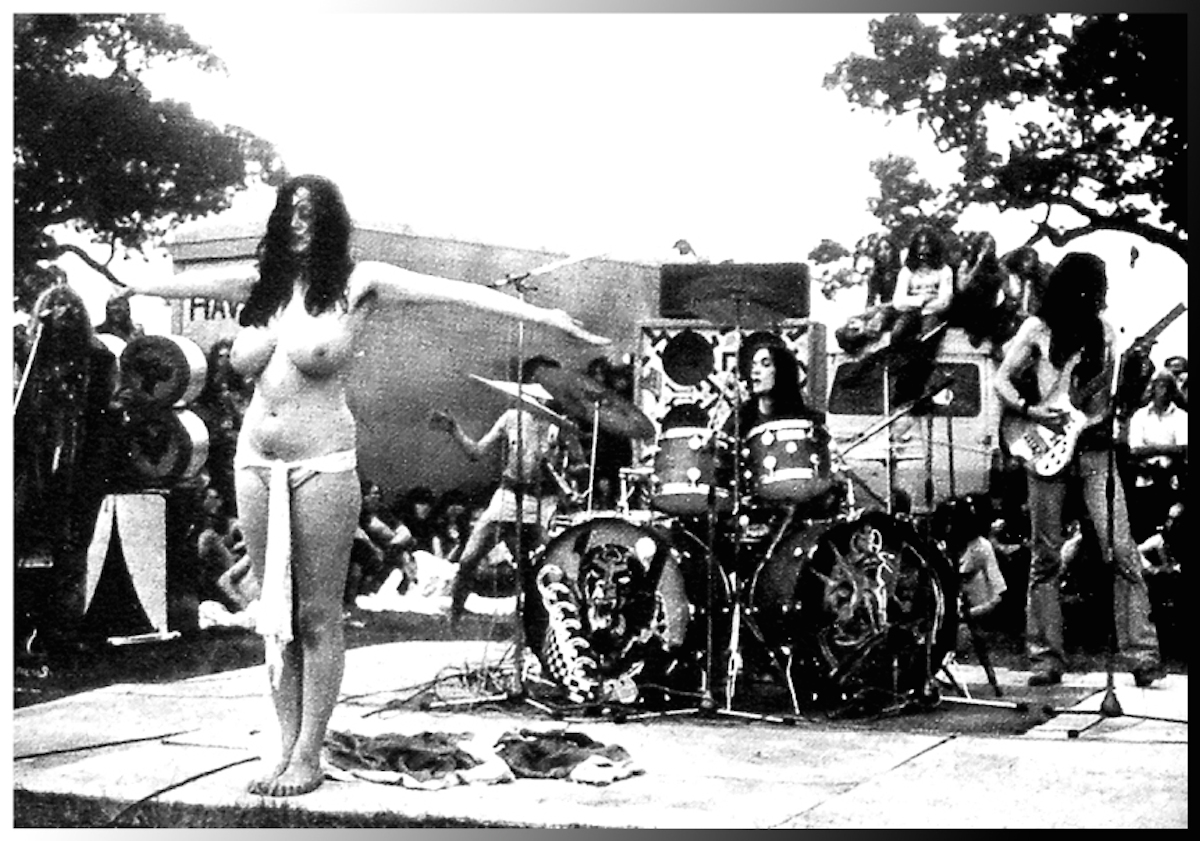 From left: Nik Turner, Stacia Blake, Simon King and Lemmy during Hawkwind's set at the Windsor Free Festival on August 25, 1973. Note the drumhead on the left. Photographer: Unknown