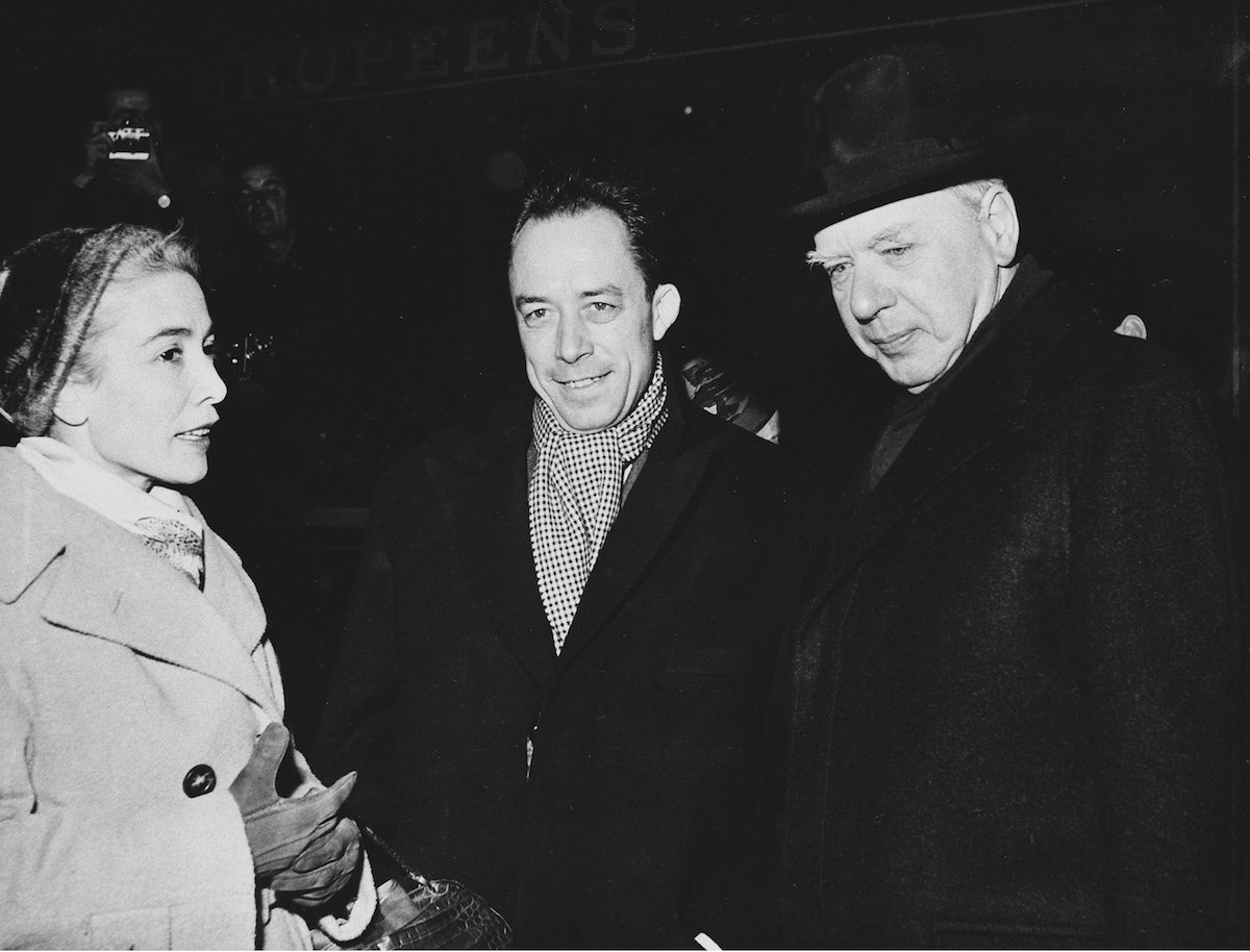 French novelist Albert Camus, center, winner of the 1957 Nobel Prize for Literature, is accompanied by his wife Francine as he arrives from Paris at the Stockholm, Sweden, Central Station, on . The couple is met at the station by Dr. Anders Osterling, permanent secretary of the Swedish Academy of Letters 9 Dec 1957