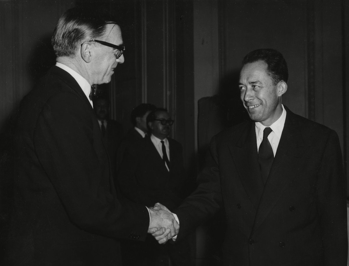 Sweden's ambassador to France, Ragnar Kumlin, left, congratulates French writer Albert Camus, after he was declared as winner of the Nobel Prize for literature, at the Gallimard book publishers in Paris, France 17 Oct 1957