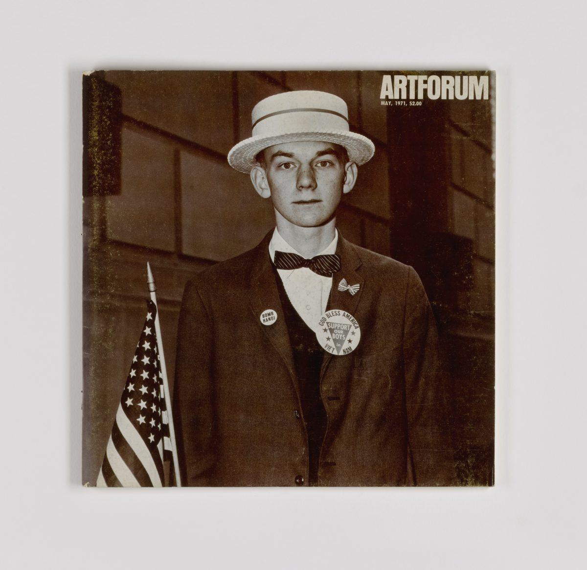 Diane Arbus, Boy with a straw hat waiting to march in a pro-war parade, cover of Artforum, May 1971