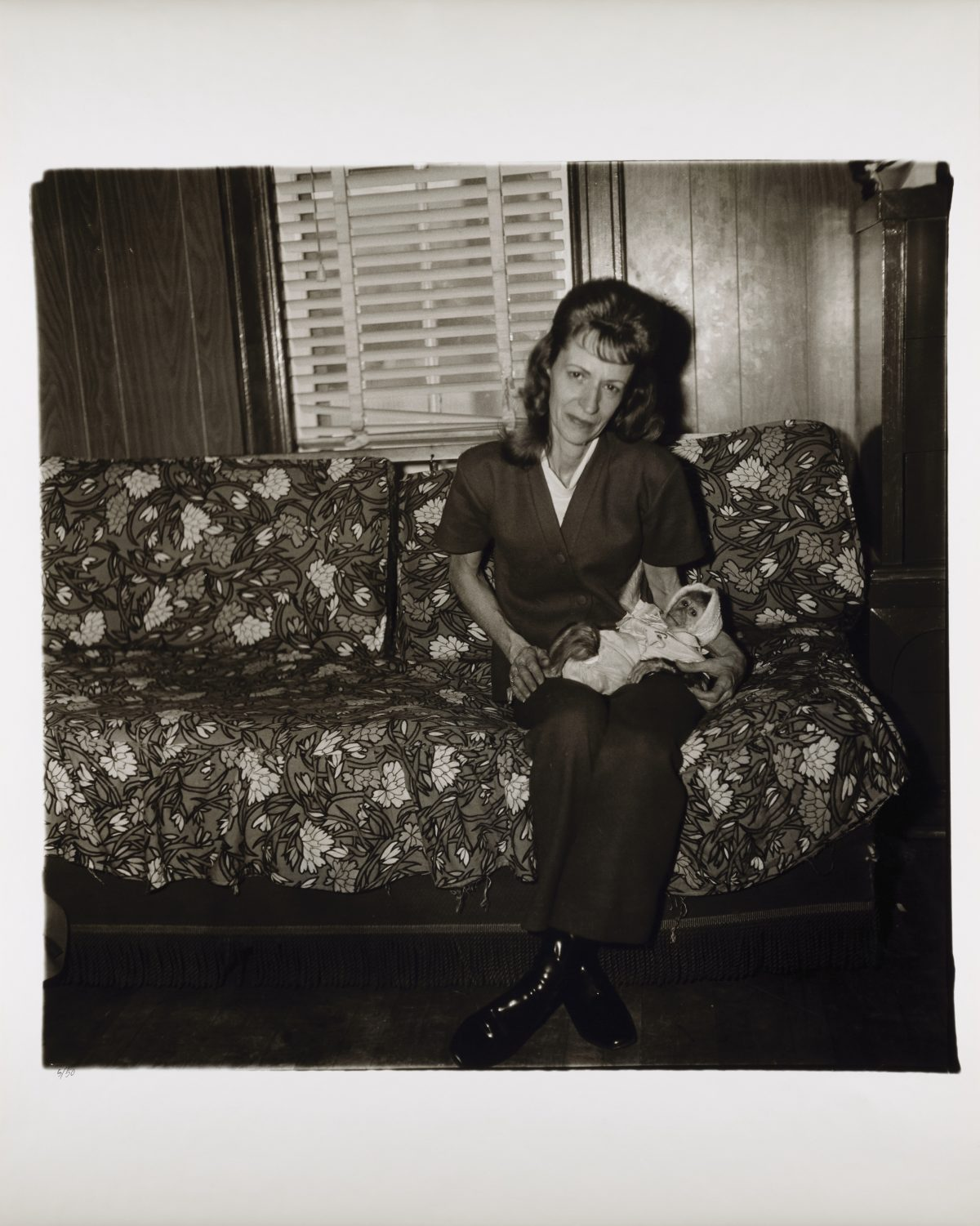 Diane Arbus, A woman with her baby monkey, N.J. 1971, 1971