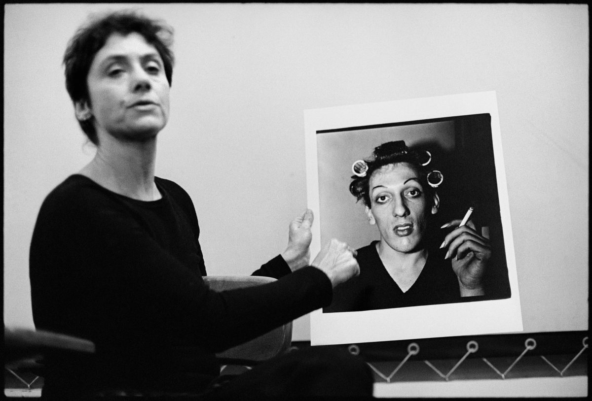 Stephen Frank, Diane Arbus with her photograph A young man in curlers at home on West 20th Street, N.Y.C. 1966, during a lecture at the Rhode Island School of Design in 1970