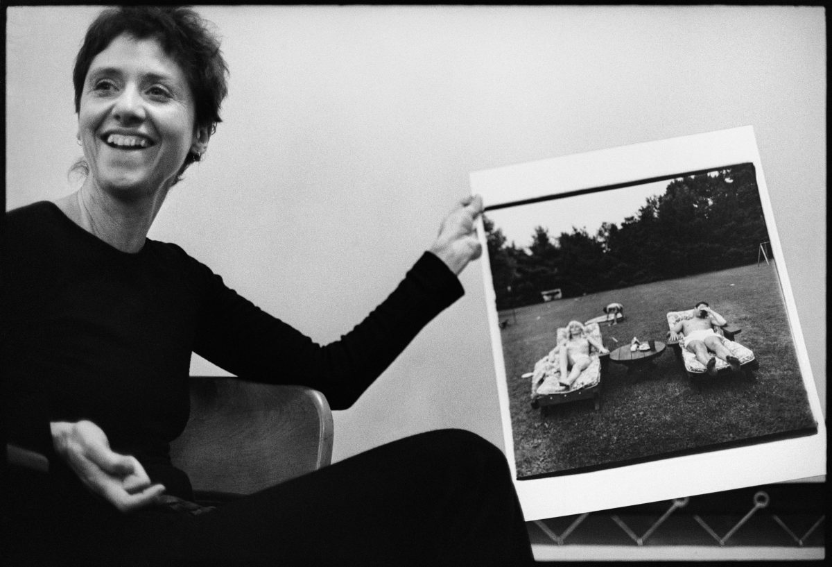 Stephen Frank, Diane Arbus with her photograph A family on their lawn one Sunday in Westchester, N.Y. 1968, during a lecture at the Rhode Island School of Design in 1970