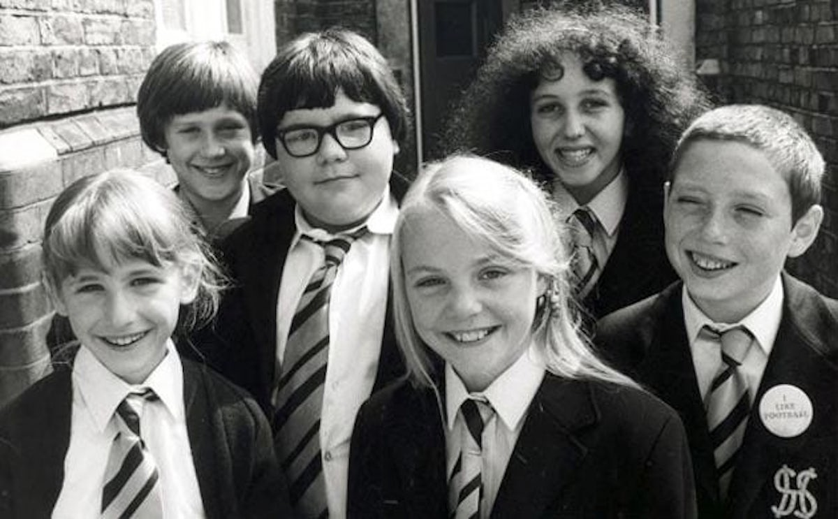 The cast in 1982, featuring characters Roland Browning (third from left), Fay Lucas (fourth from left) and Zammo Maguire (right)