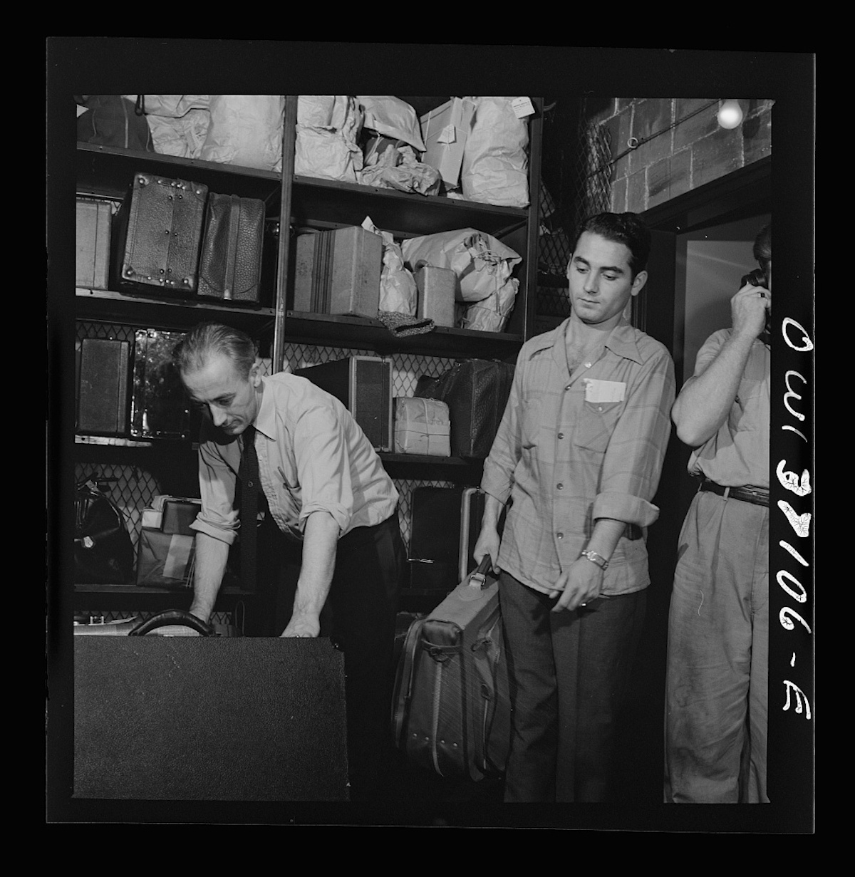 Pittsburgh, Pennsylvania. Baggage clerks at the Greyhound bus terminal