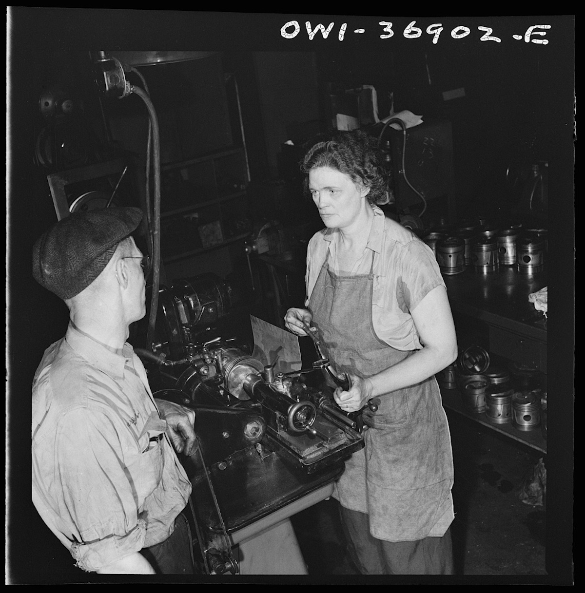 Pittsburgh, Pennsylvania. One of the women employees in the machine shop of the Greyhound garage working on a cylinder grinding machine