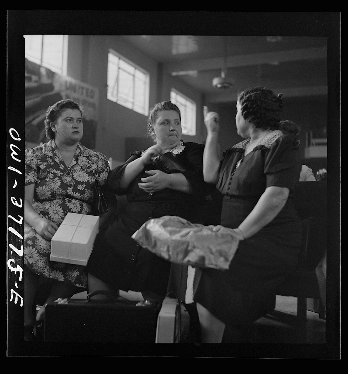 Pittsburgh, Pennsylvania. Passengers in the waiting room of the Greyhound bus terminal