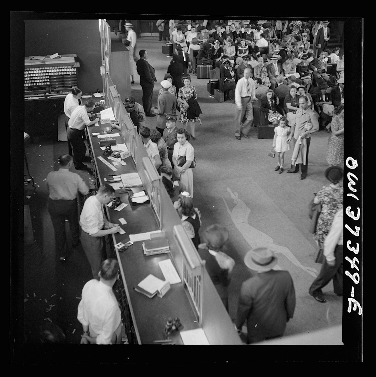 Pittsburgh, Pennsylvania. People buying tickets at the Greyhound bus terminal