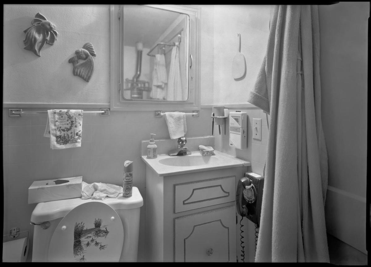 Photograph of a bathroom with a telephone in it. DATE: December 25, 1993 CREATOR: Williams, Byrd M. (Byrd Moore), IV, 1951-