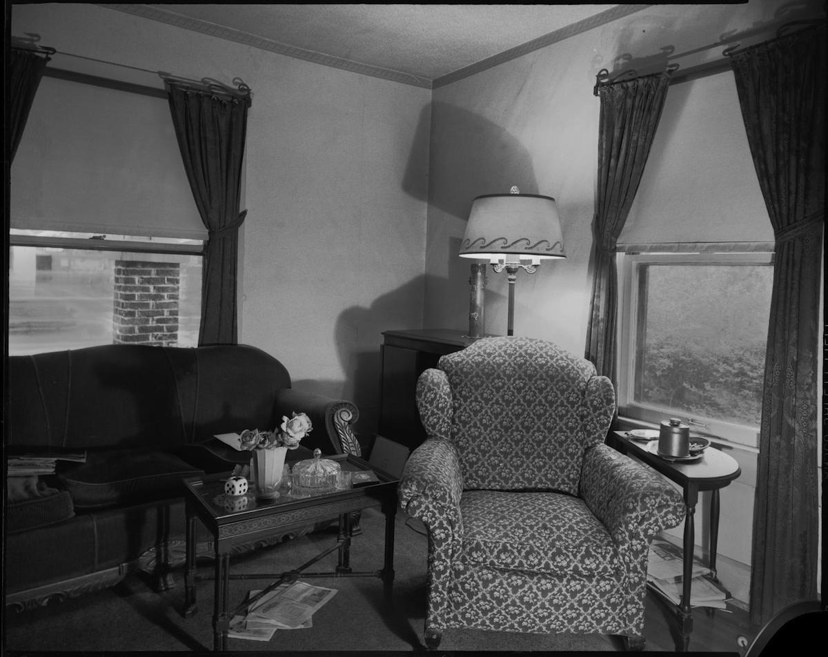 Photograph of an indoor photograph of a living room. DATE: 1940 CREATOR: Williams, Byrd M. (Byrd Moore), III
