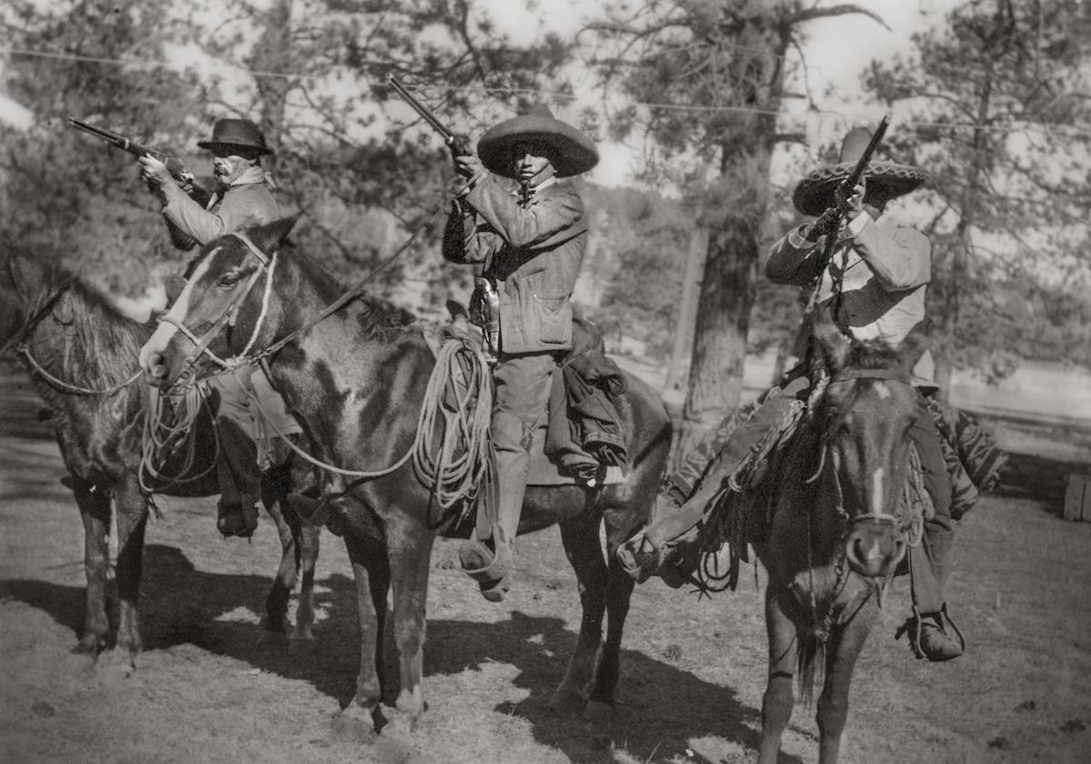 Photograph of three men with guns on horses, possibly Pancho Villa's men. CREATOR: Williams, Byrd M. (Byrd Moore), Jr.
