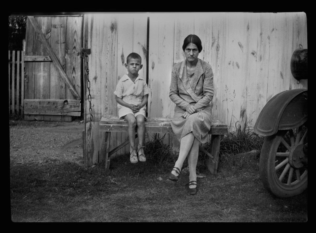 Photograph of Charles Williams sitting with his mother, Irene Biffle Williams on a bench outside. DATE: 1923 CREATOR: Williams, Byrd M. (Byrd Moore), Jr.
