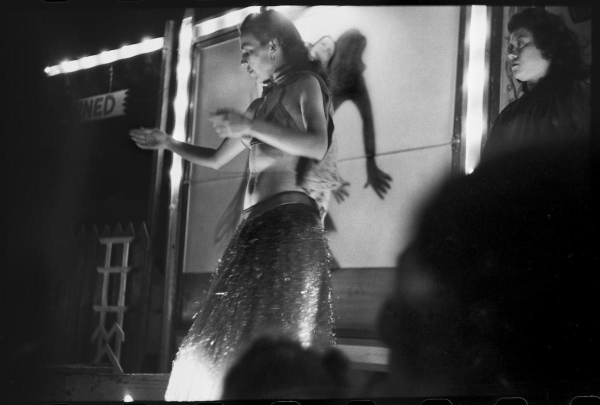 Photograph of a woman dancing in a burlesque show. CREATOR: Williams, Byrd M. (Byrd Moore), III