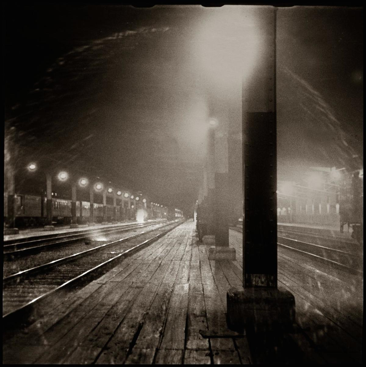 Photograph of an Amtrack station at night. CREATOR: Williams, Byrd M. (Byrd Moore), III