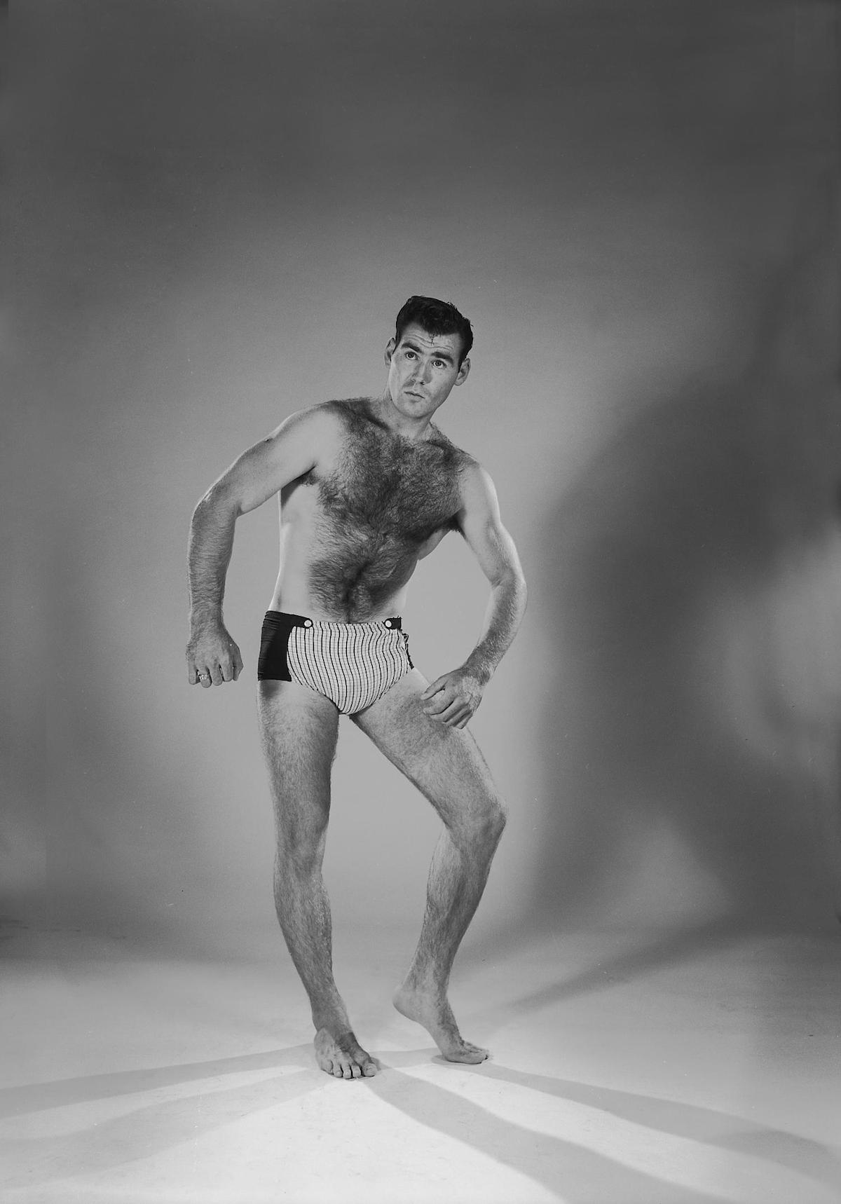 Photograph of a man named Charlie Bigley posing in shorts for a portrait. CREATOR: Williams, Byrd M. (Byrd Moore), III