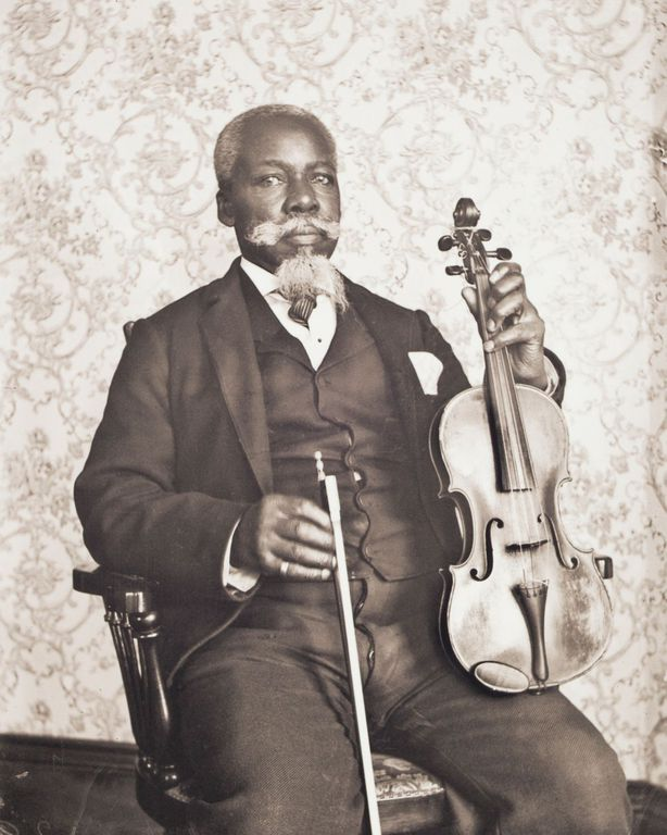 c. 1900 Portrait of David T. Oswell with His Viola. David Oswell, born in Boston, emigrated from St. John's, New Brunswick, Canada, to Worcester in 1877. Oswell taught violin and guitar to prominent white families, writing musical scores performed throughout the city.