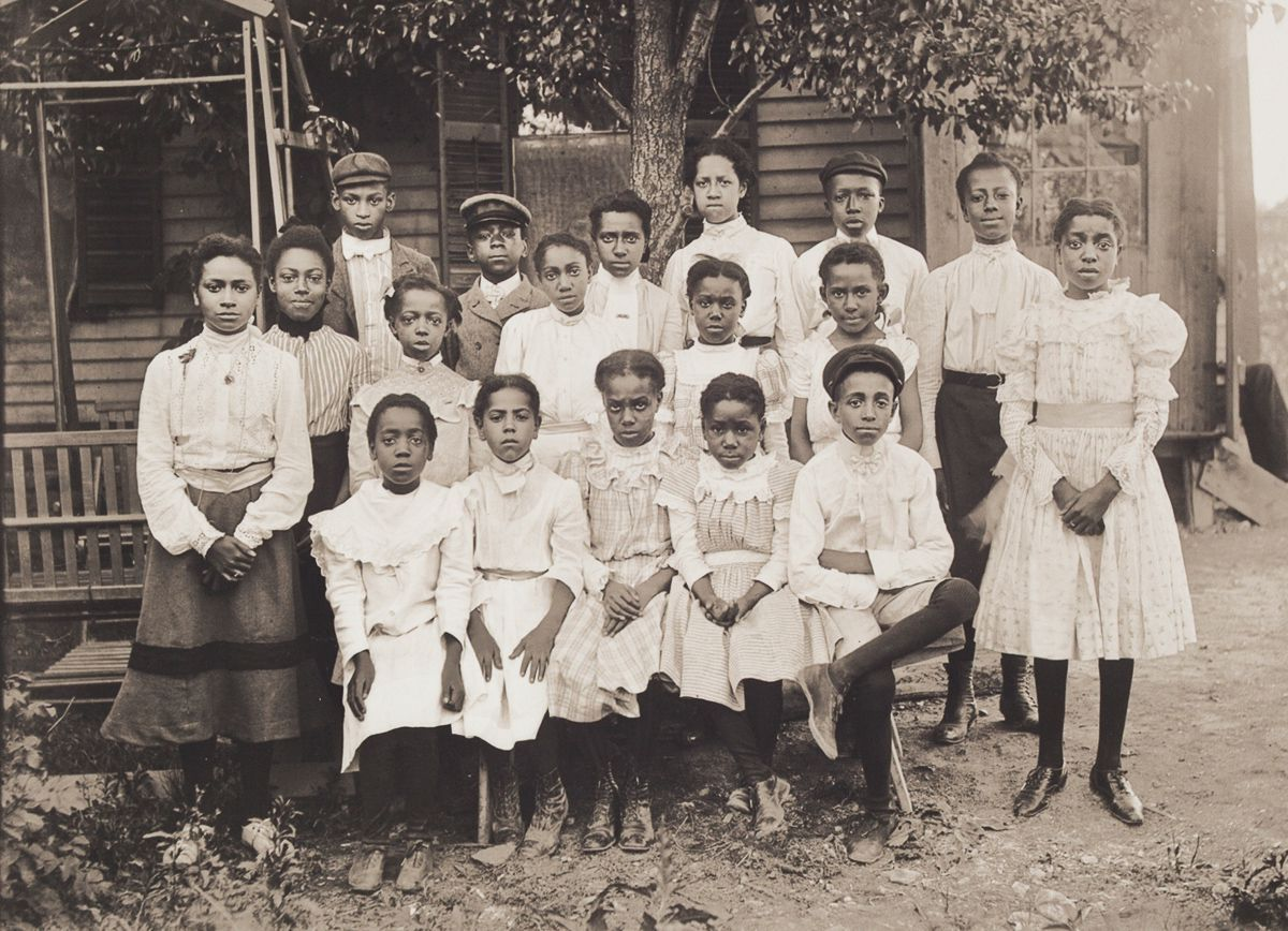 c. 1901 Portrait of Eighteen Girls and Boys at Sunday School. These girls and boys are probably Sunday School students from Bethel AME Church, dressed in black and white for the communion service held once a month, a tradition that continues to this day.