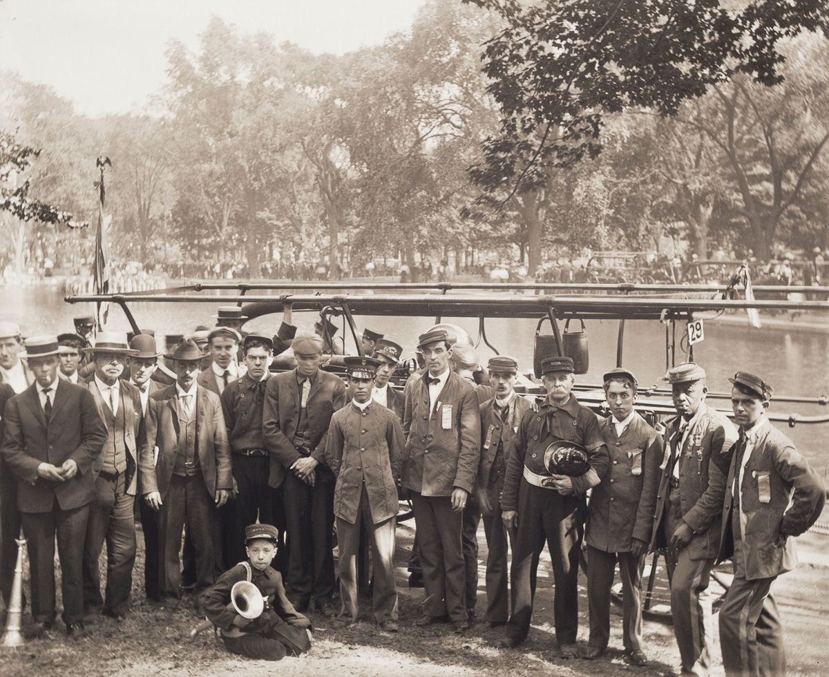 1907 Portrait of Members of the Worcester Veterans Firemen's Association. This photograph was likely taken at a firemen's muster in Worcester's Elm Park. Musters usually lasted two days, attracting the attendance of thousands and consisting of skill based competitions between local and visiting fire companies.