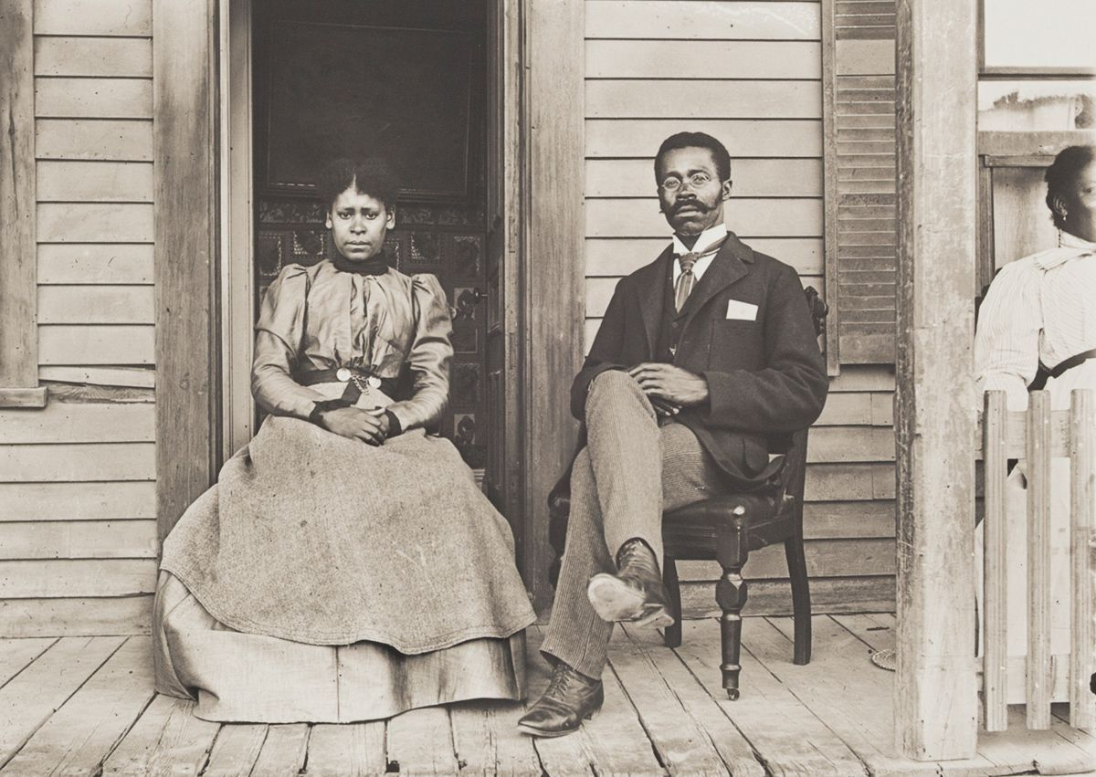c. 1902 Portrait of Betty and Willis Coles. Posing on the porch of their home on Park Avenue, these Virginia migrants arrived in Massachusetts in the 1890s. Willis, who was a day laborer when this portrait was made, later became a pastor in Springfield, Massachusetts.