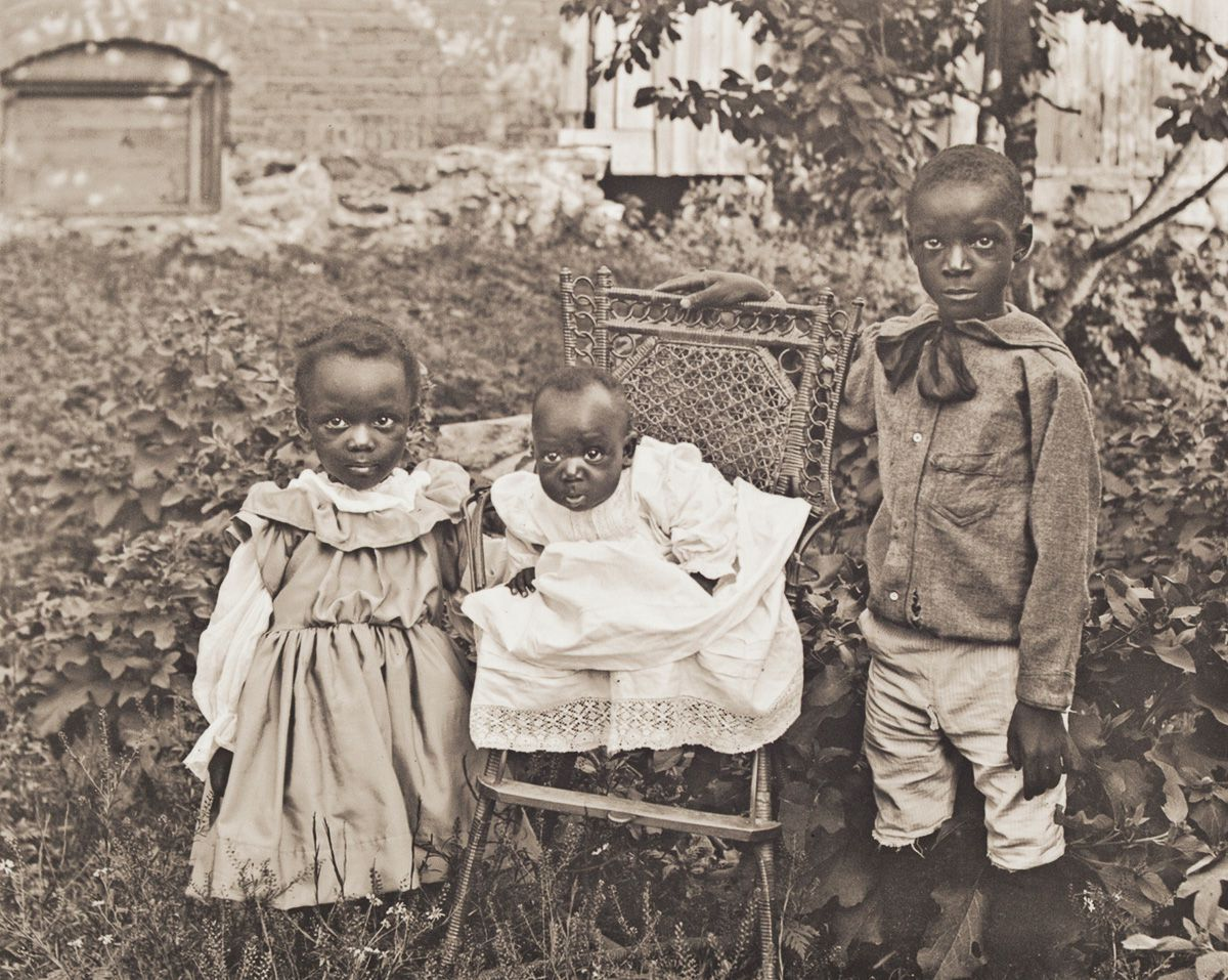 "1901 Portrait of Hattie, James Harold, and Clarence Ward. Hattie, Louis, Clarence, and James Harold Ward were the children of Mary Elizabeth Ward Wilson, a migrant from New Bern. James Harold, better known as ""Boot,"" eventually became a jazz drummer. Given the moniker ""Hooks,"" Clarence became the proprietor of a restaurant. Hattie worked as an assistant in a dentist's office."