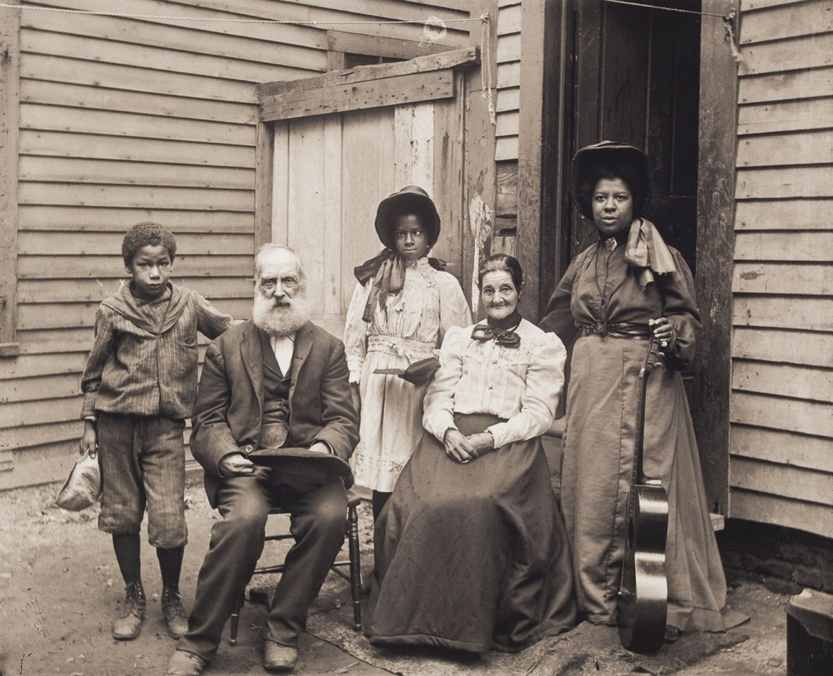 c. 1906 Portrait of a Mixed-Race Group, Including a Woman With a Guitar. This group may have been entertainers at an Old Home Days celebration, a popular event at the turn of the century held to commemorate the area's rural past.