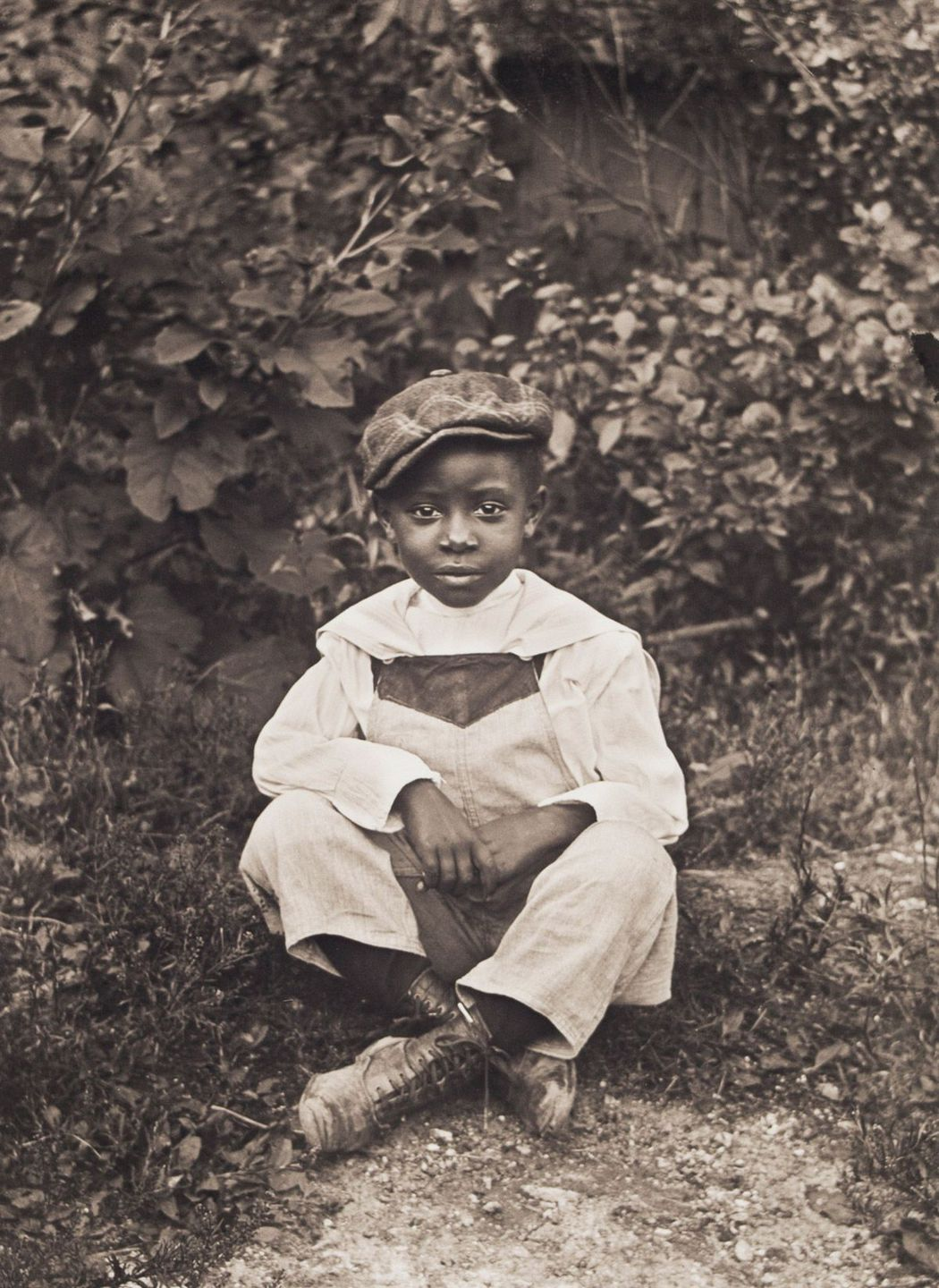 c. 1904 Portrait of Boy Sitting on Grass.