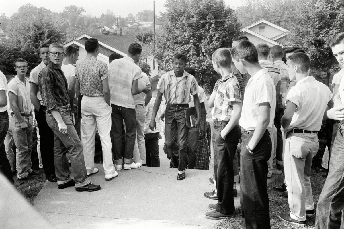 School Desegregation, 1956. A Black Student Walking Through A Crowd Of White Boys In Clinton, Tennessee, During A Period Of Violence Related To School Integration, 4 December 1956. Photographed By Thomas J. O'Halloran.
