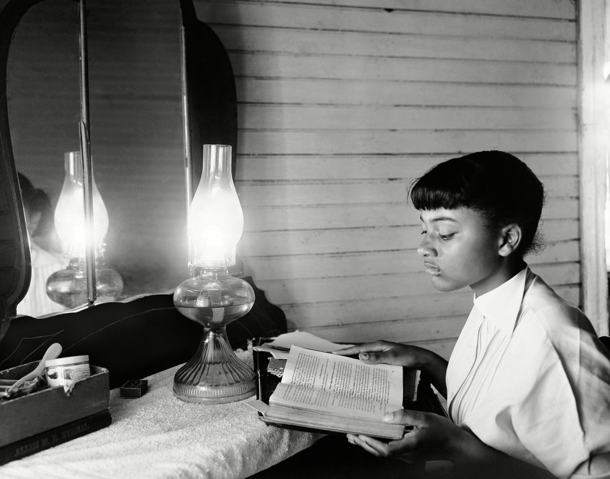 "By the light of a kerosene lamp, 14-year-old Henrietta Hilton studies in her tenant farm home in Summerton, S.C., on . She is in the ninth grade. Discussing the Supreme Court decision against school segregation, Henrietta says: ""I'd like to go to school with white children... I think I'd enjoy being friends with some white girls. Maybe they'd enjoy being friends with me African American Integration Schools SC 1954, Summerton, USA"