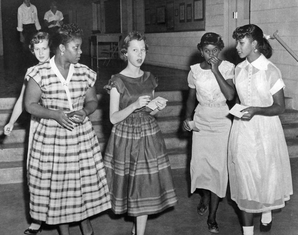 Two unidentified white sophomores show their new classmates around the Fayetteville, Ark., high school, . The formerly all-white school now has five black students registered for classes. Fayetteville was the first school district in the old Confederate south to end racial segregation. Students of both races saw nothing unusual about the situation Civil Rights School Desegregation 1954