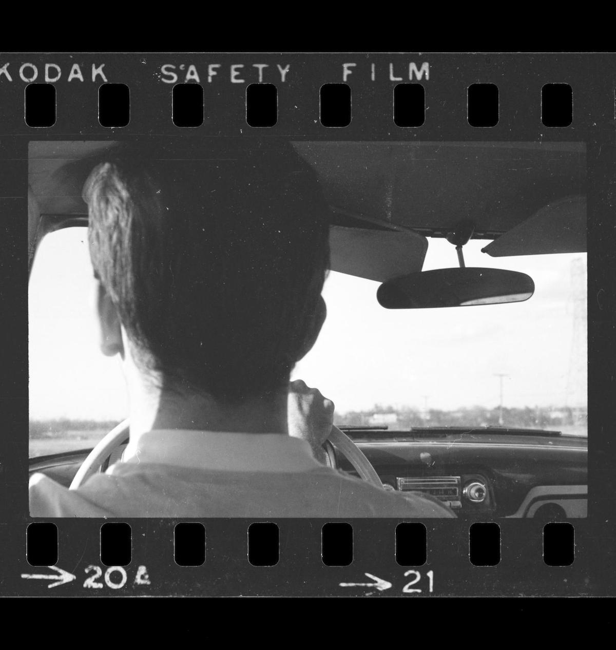 Williams, Byrd Moore, IV. [Photo of a man driving a car], photograph, 1967