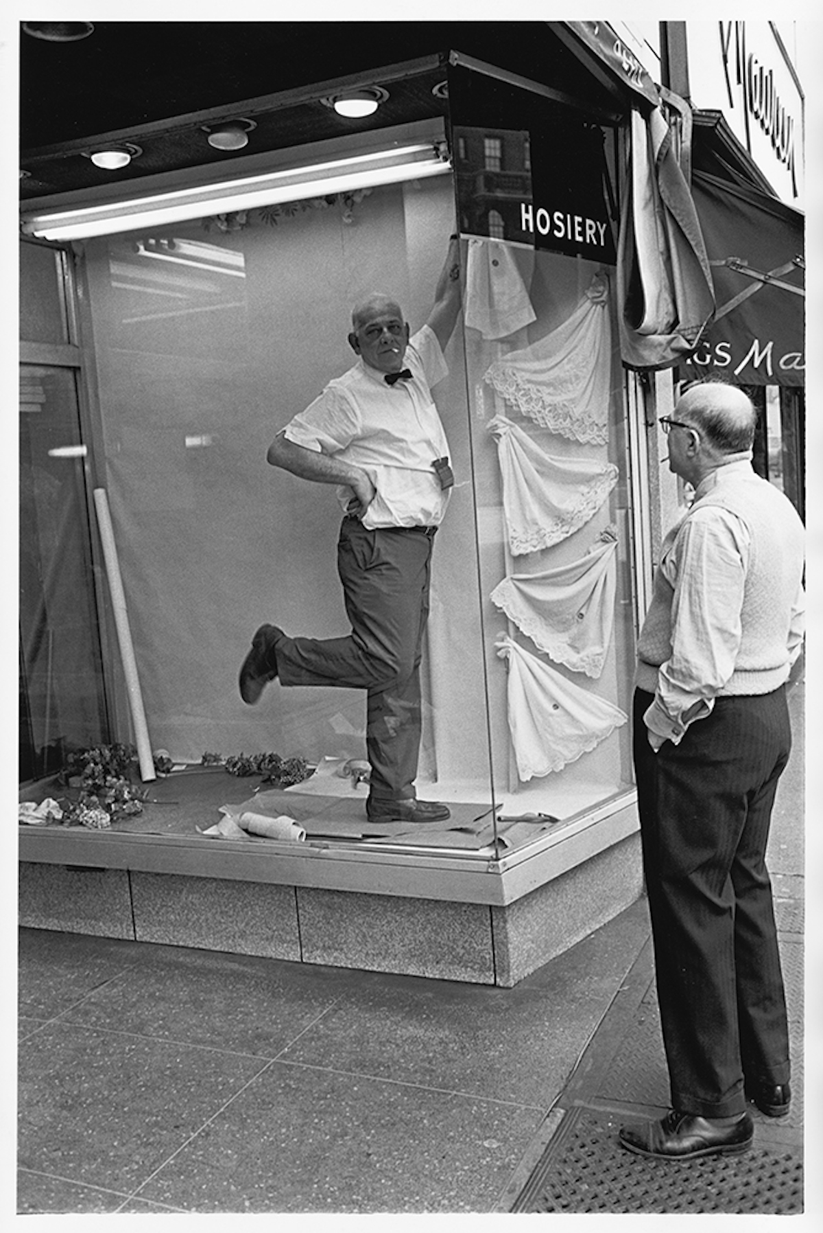 Window dresser striking a pose, 1960s