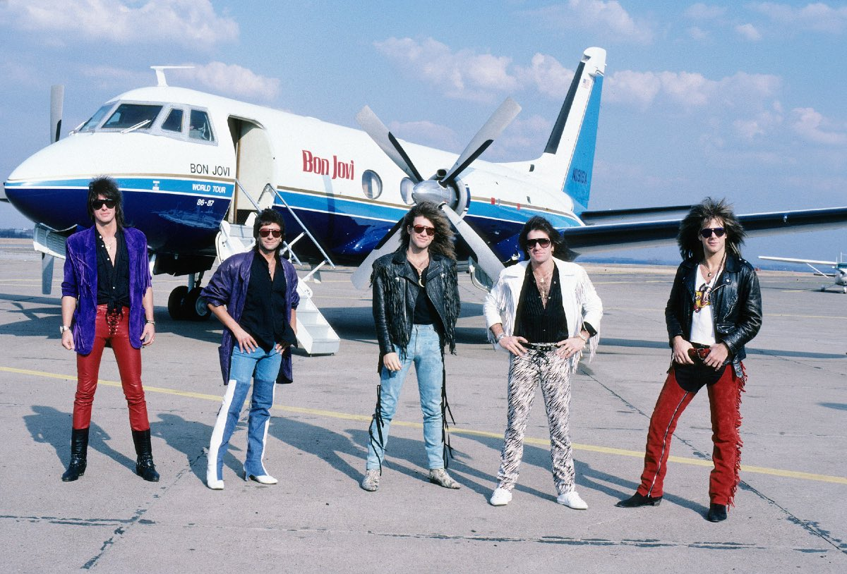 Bon Jovi with the band's plane during their 86-87 World Tour, March 1987