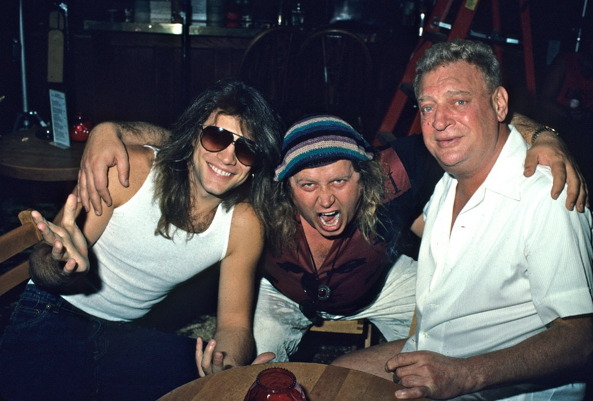 "Jon Bon Jovi, Sam Kinison and Rodney Dangerfield during the ""Wild Thing"" video shoot, September 1988"
