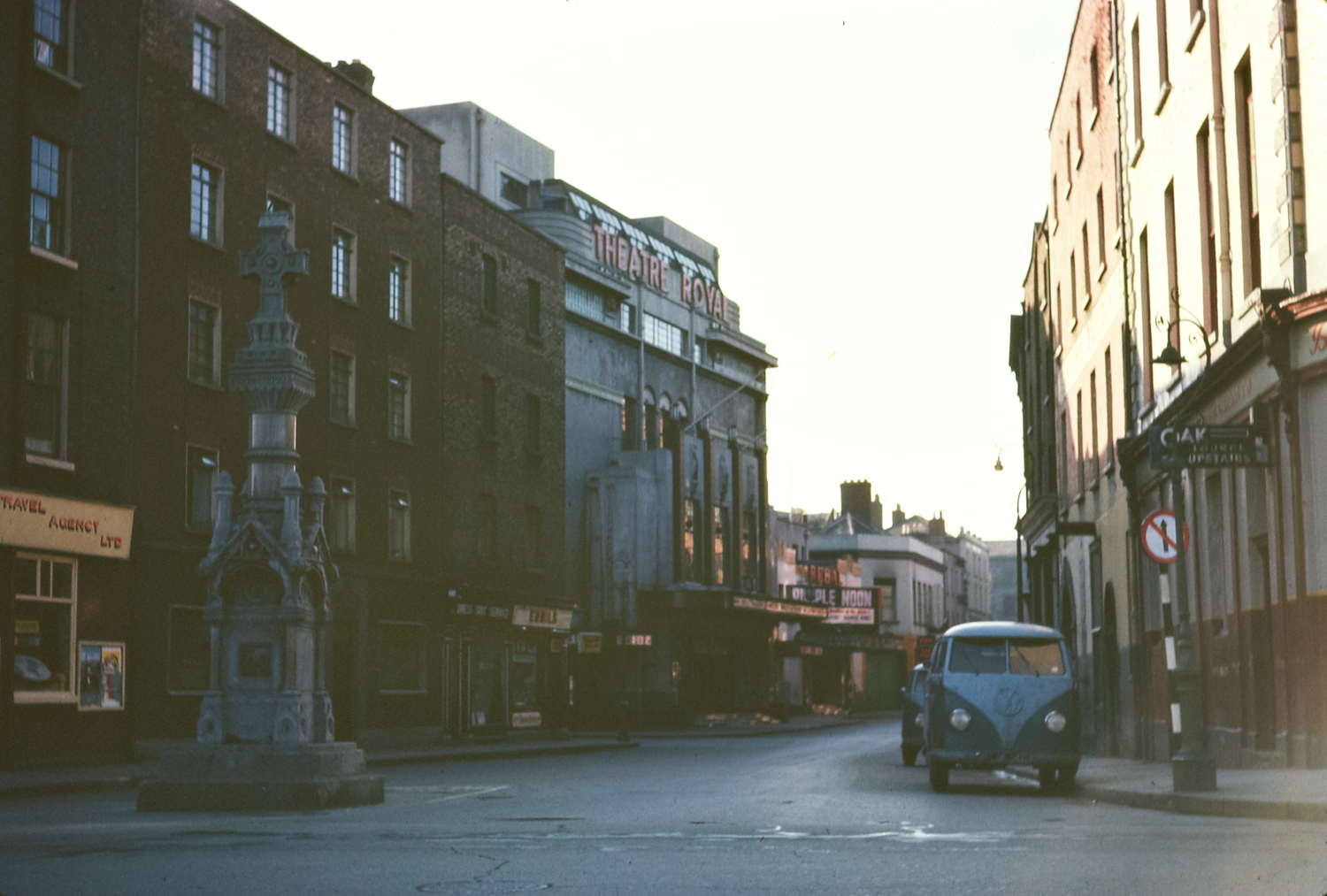 "Ireland 1960s, The late lamented Theatre Royal on Hawkins Street in Dublin. Thanks to swordscookie for this information on the monument in the foreground: ""Monument to Constable Jeremiah Sheehan, 6' 4"" tall of the DMP who went down into a drain at this point to rescue some council workmen who had been overcome with sewer gas and lost his own life!"" Niall McAuley contributed this brilliant link outlining the long history of the Theatre Royal ""including the programme of the final show, the ""Royale Finale"", which was on Saturday 30th of June at 8pm, just three months after this photo."" Date: Sunday, 1 April 1962"