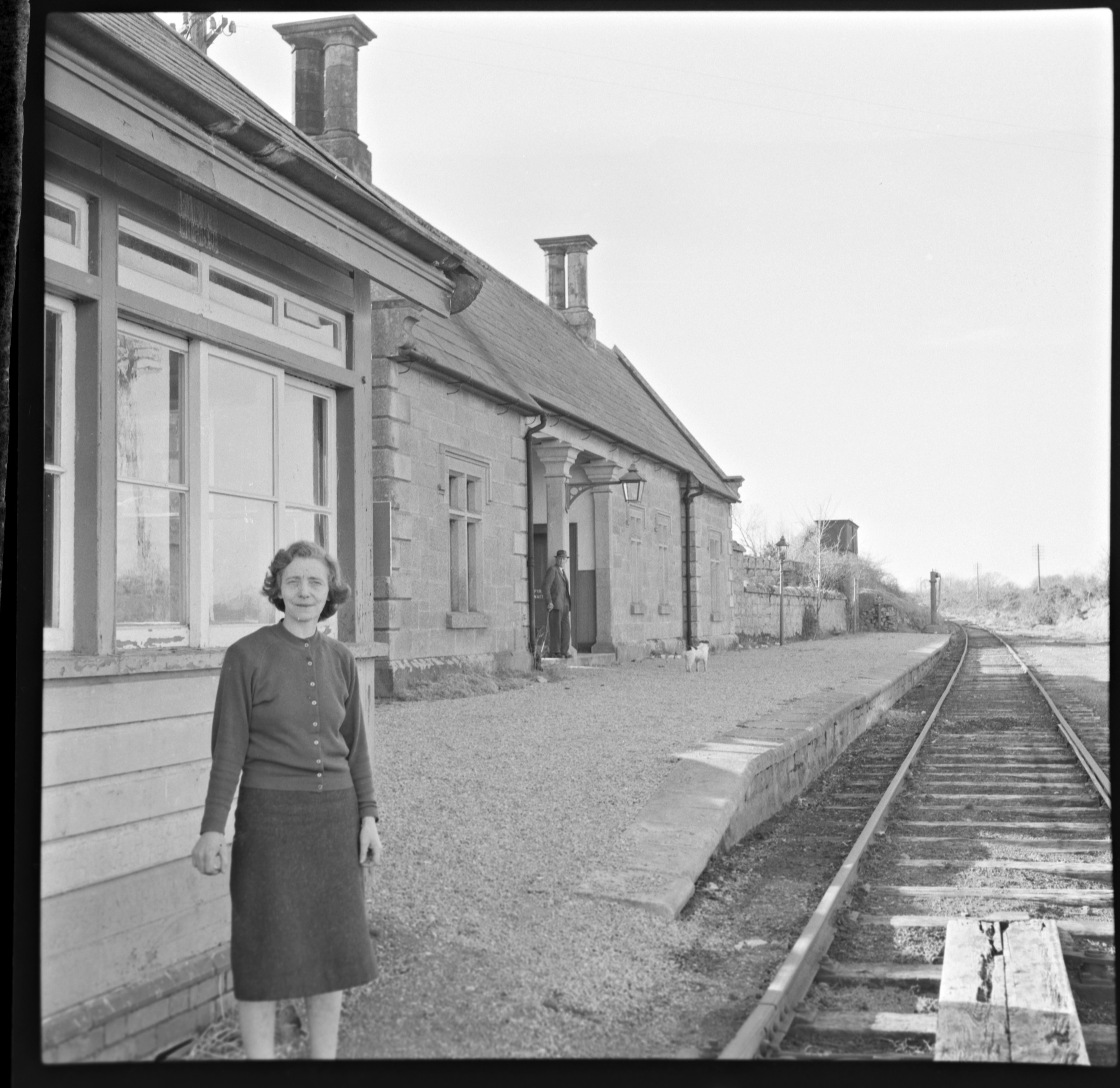Ireland 1960s, March 23, 1963 This is Mrs Lawlor, pictured at Borris Train Station in Co. Carlow. She has a friendly, but compelling gaze. This photo was taken just days before this train station closed forever on 1 April 1963.