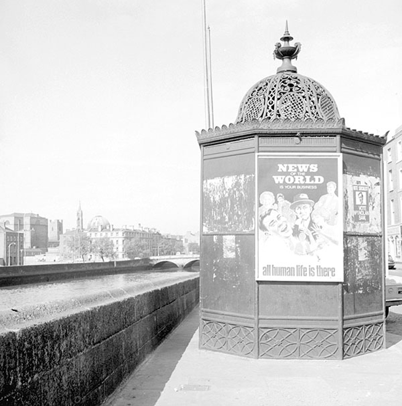 Ireland 1960s, news of the world, pisspoir, A very ornate urinal on Ormond Quay, Dublin featuring a poster ad for the News of the World. Photographer: Elinor Wiltshire Date: 1969