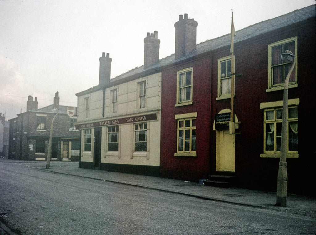 Manchester pubs, View along Rosamond Street West from Cambridge Street, with the Sikh temple (Gurdwara) and the York Minster pub on the corner of Higher Chatham Street, around 1967.