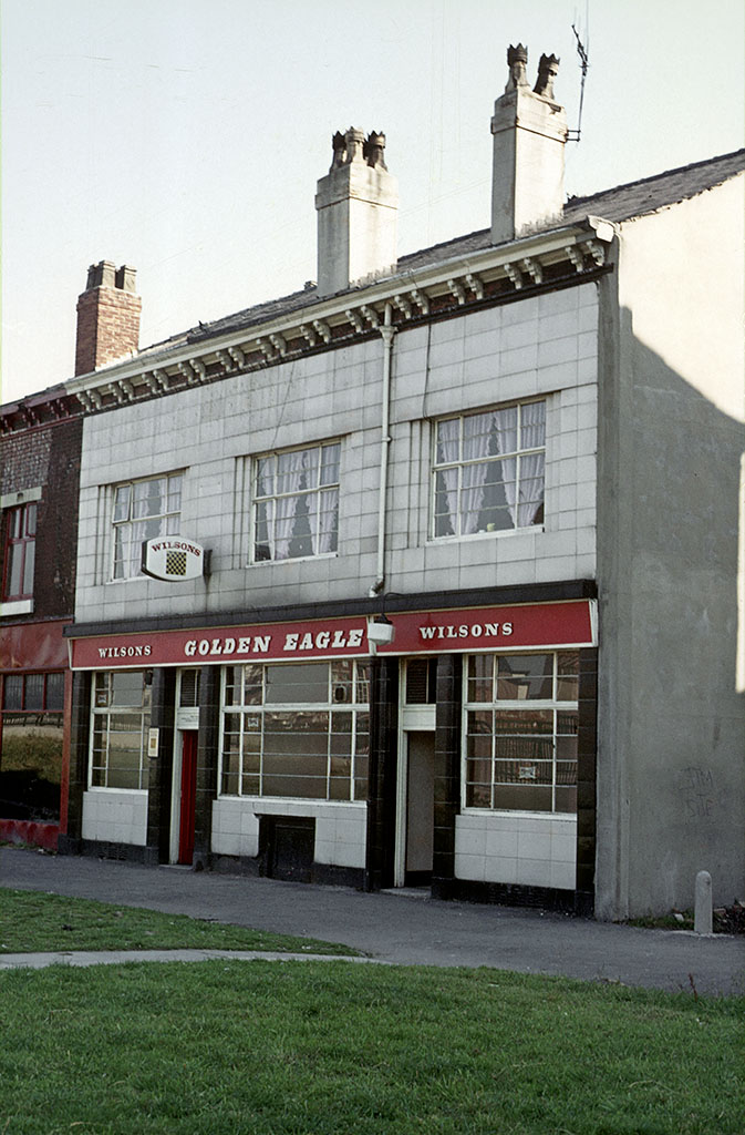 Manchester pubs, The Golden Eagle, Hulme c. 1973 The Golden Eagle pub on Hulme Walk, Hulme, photographed a few years before its closure in 1976. The pub and the post office next door stood on part of the site now occupied by MMU's new Birley Fields campus.