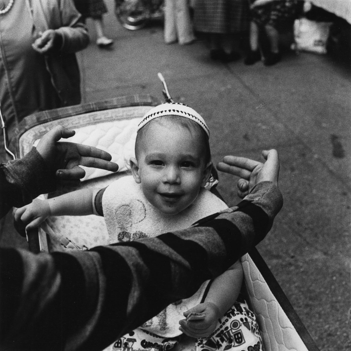 A future Talmudic student being pointed out by my photography student Michael Marsh at The Lower East Side Street Festival - NY, NY June 1978