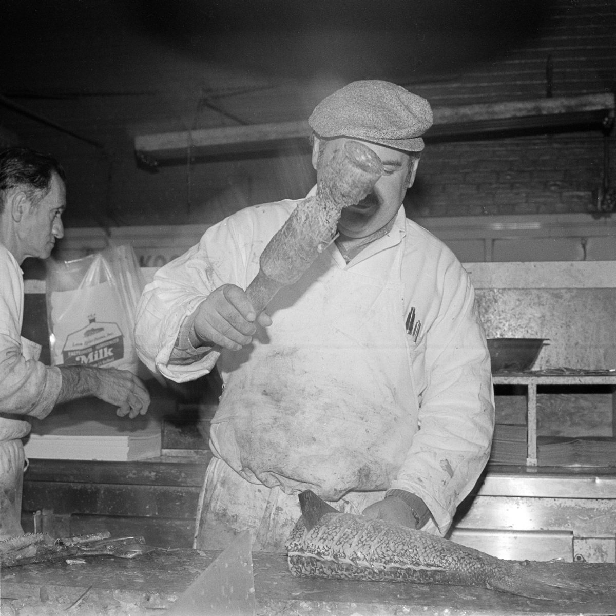 Slicing fish at Essex Street Market - New York, NY October 1978