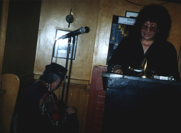 Mick Farren with (back to camera) Larry Wallis, Filthy McNasty's, north London, November 2001. Photo: Unknown