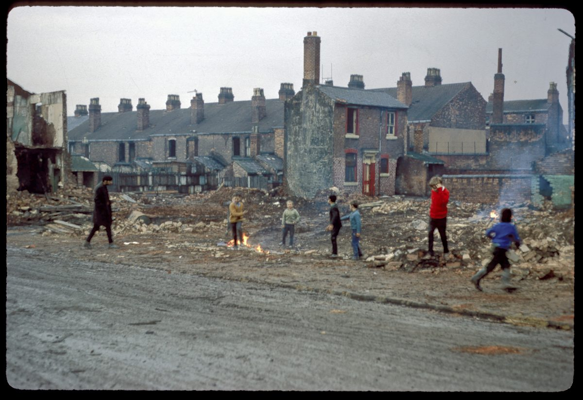 Photograph of the demolition of terrace houses, Anderton Street, off Shakespeare Road, Ladywood and children playing