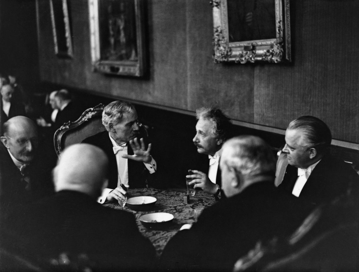 British Prime Minister Ramsay MacDonald chats with Albert Einstein at a reception in Berlin in August 1931