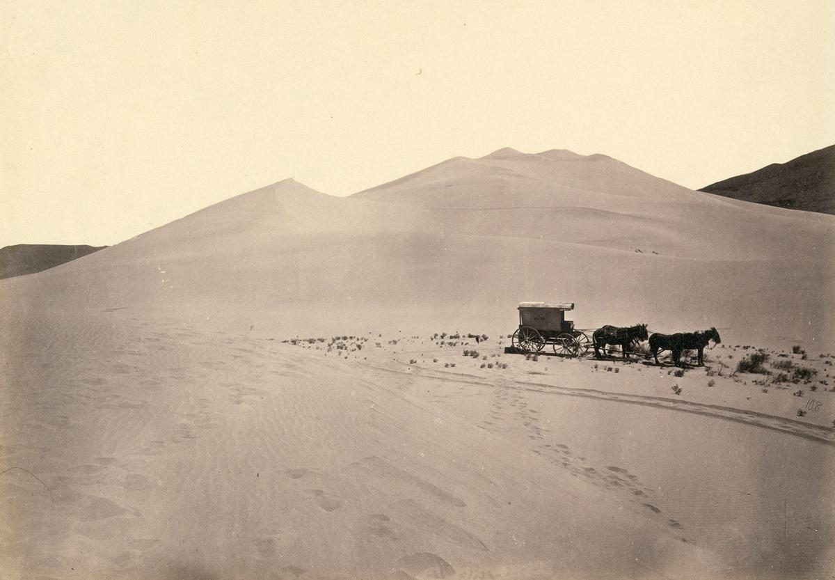 Timothy O'Sullivan's darkroom wagon, pulled by four mules, entered the frame at the right side of the photograph, reached the center of the image, and turned around, heading back out of the frame. Footprints lead from the wagon toward the camera, revealing the photographer's path. Photo taken in 1867, in the Carson Sink, part of Nevada's Carson Desert